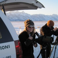 Guests use spotting scopes to view wildlife.